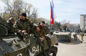 637719-armed-men-sit-on-an-armoured-personnel-carrier-with-a-russian-flag-on-it-in-slaviansk