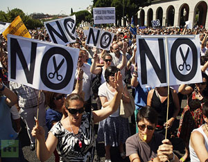 Civil servants shout slogans during a protest against government austerity measures in Madrid