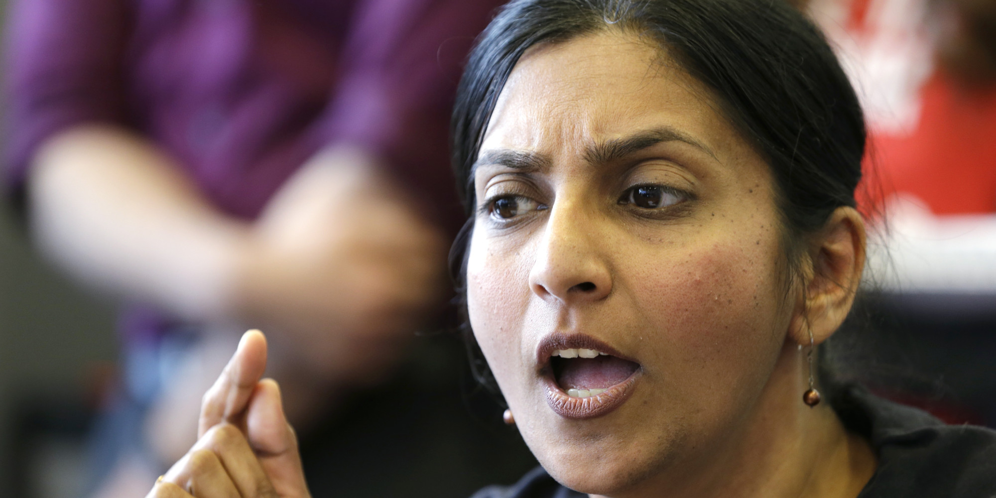 FILE -- In this April 24, 2014, file photo, Seattle City Council Member Kshama Sawant addresses a news conference on a proposal to increase the minimum wage in the city, in Seattle. Sawant said she'll join the May Day march Thursday, May 1, 2014, for immigrant and worker rights to promote her campaign for a $15 minimum wage. May Day has turned violent recently in Seattle, where last year police arrested 18 people from a crowd that pelted them with rocks and bottles. A year earlier masked marchers dressed in black broke windows and doors on downtown banks and stores and tried to set a fire at a federal building. (AP Photo/Elaine Thompson, File)